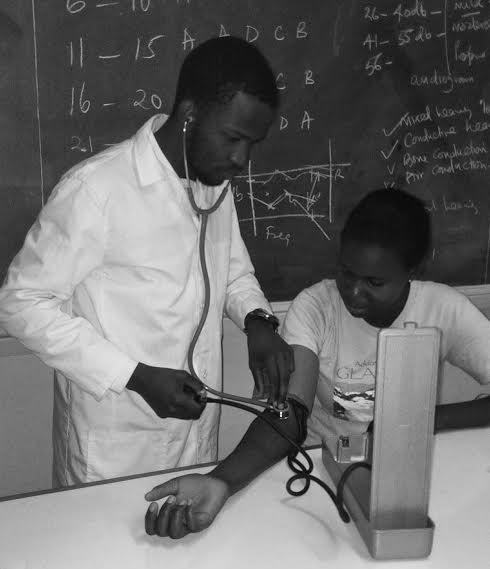 Students during a practical lesson on taking patient's blood pressure