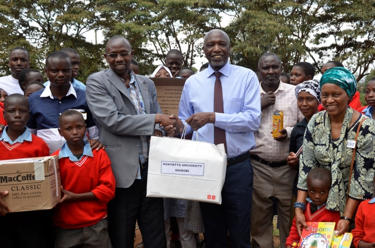 KU DONATES TEACHING MATERIAL TO DEVASTATED SOLAI SCHOOL..